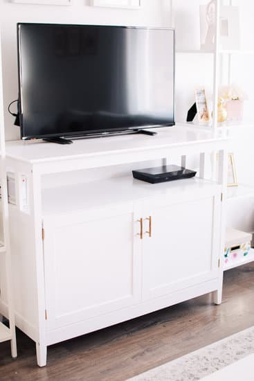 Tv and updated white tv stand in living room.