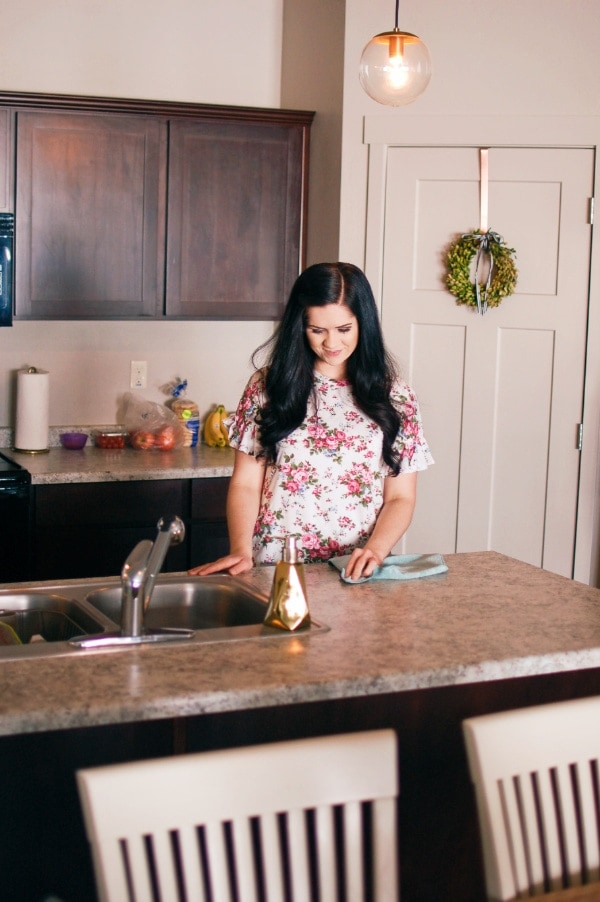 Woman uses ecloth to clean kitchen counters.