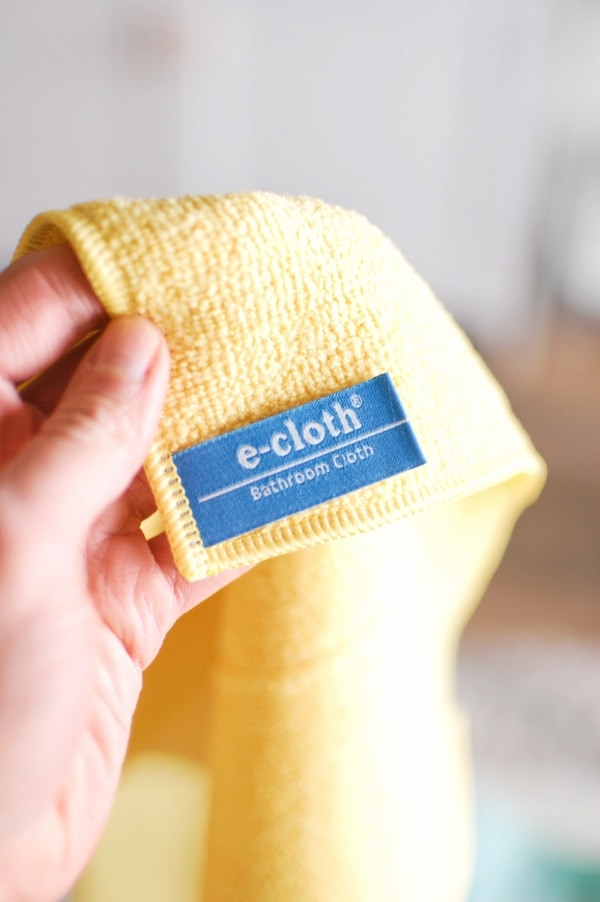 Woman holds yellow ecloth.