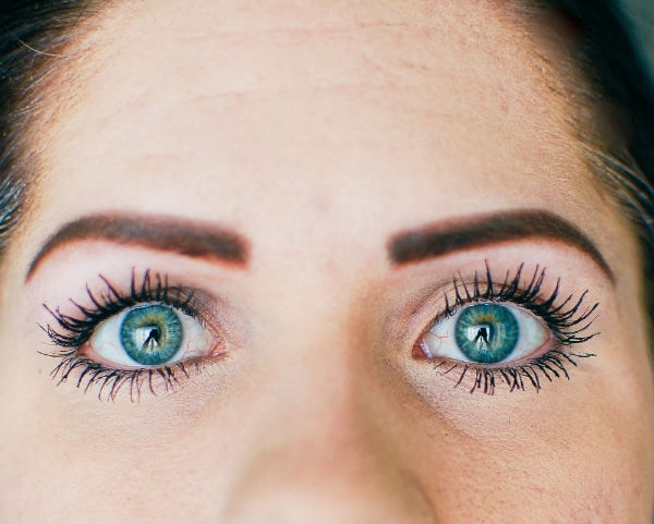 Woman shows off long eyelashes