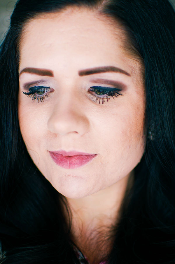 Woman shows off effects of eyelash enhancing serum product