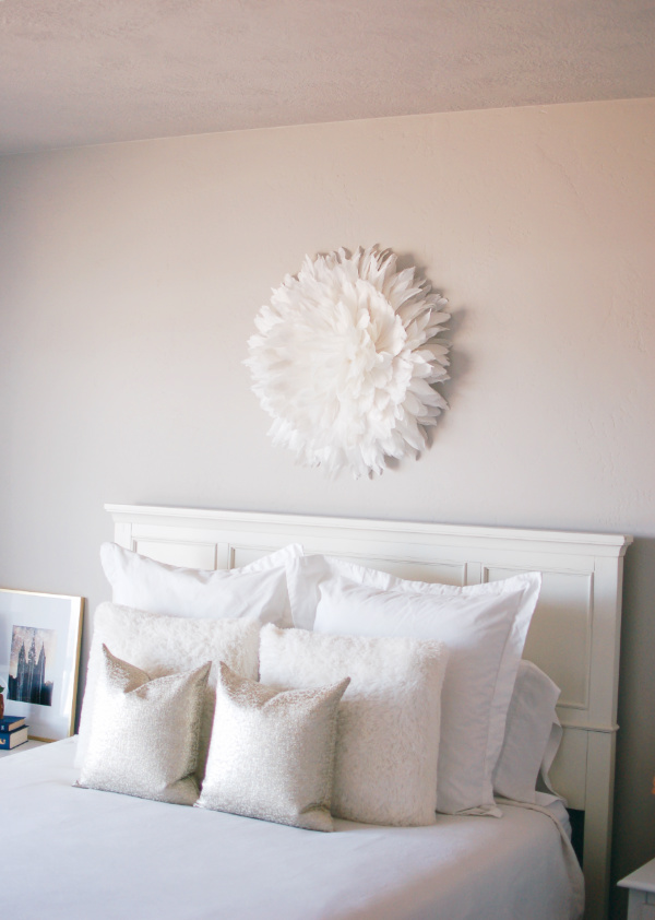 White Juju hat on a bedroom wall.