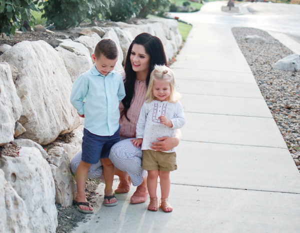 Mother with children looking to the future and thinking of her best advice for teenagers.