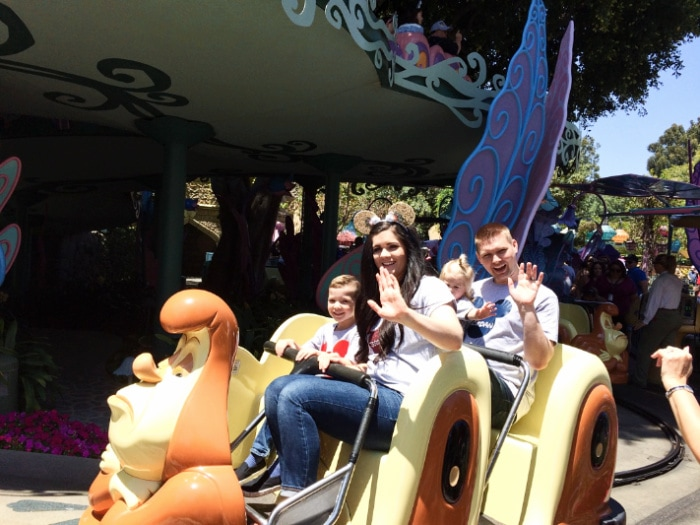 Family uses Disneyland fastpass and waves on the Alice in Wonderland ride