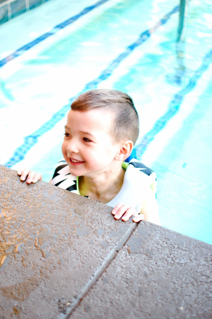 Little boy swims at a hotel near Disneyland.