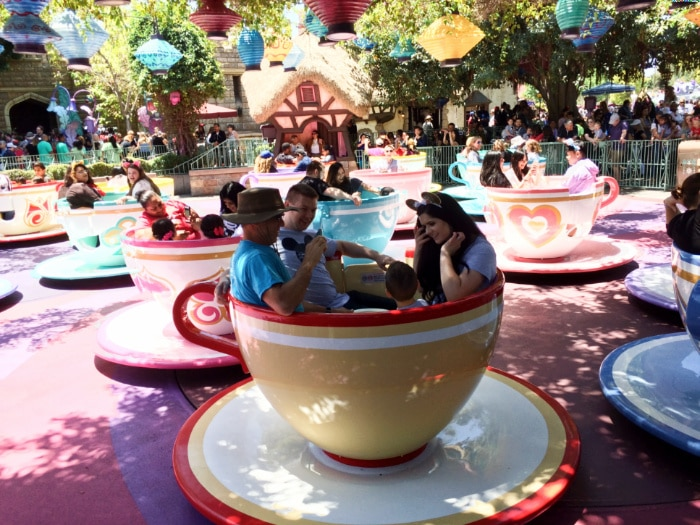 Family rides the teacups with the best Disneyland tips.