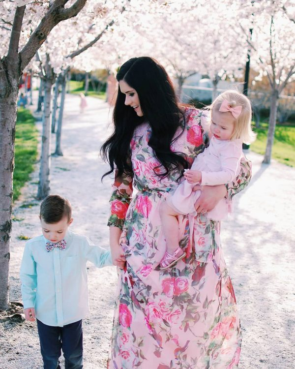 Mom walks with kids during spring family photos.