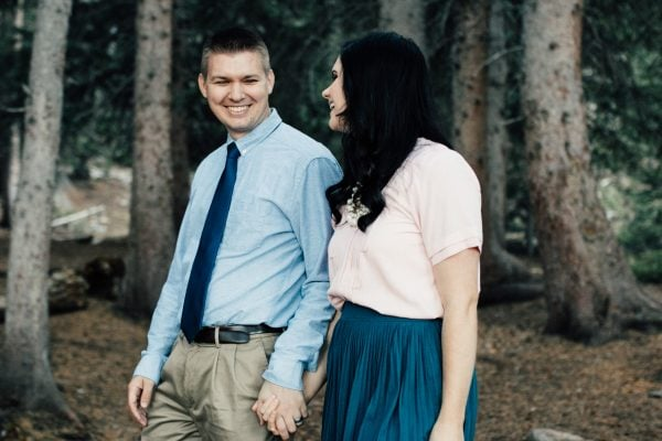 Couple laughs during family photo shoot.
