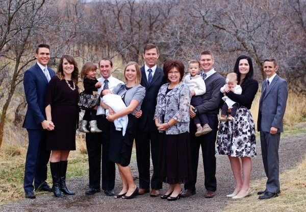 Large family wears white and black for photo shoot.