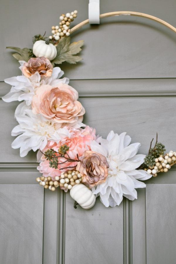 Embroidery hoop wreath on door