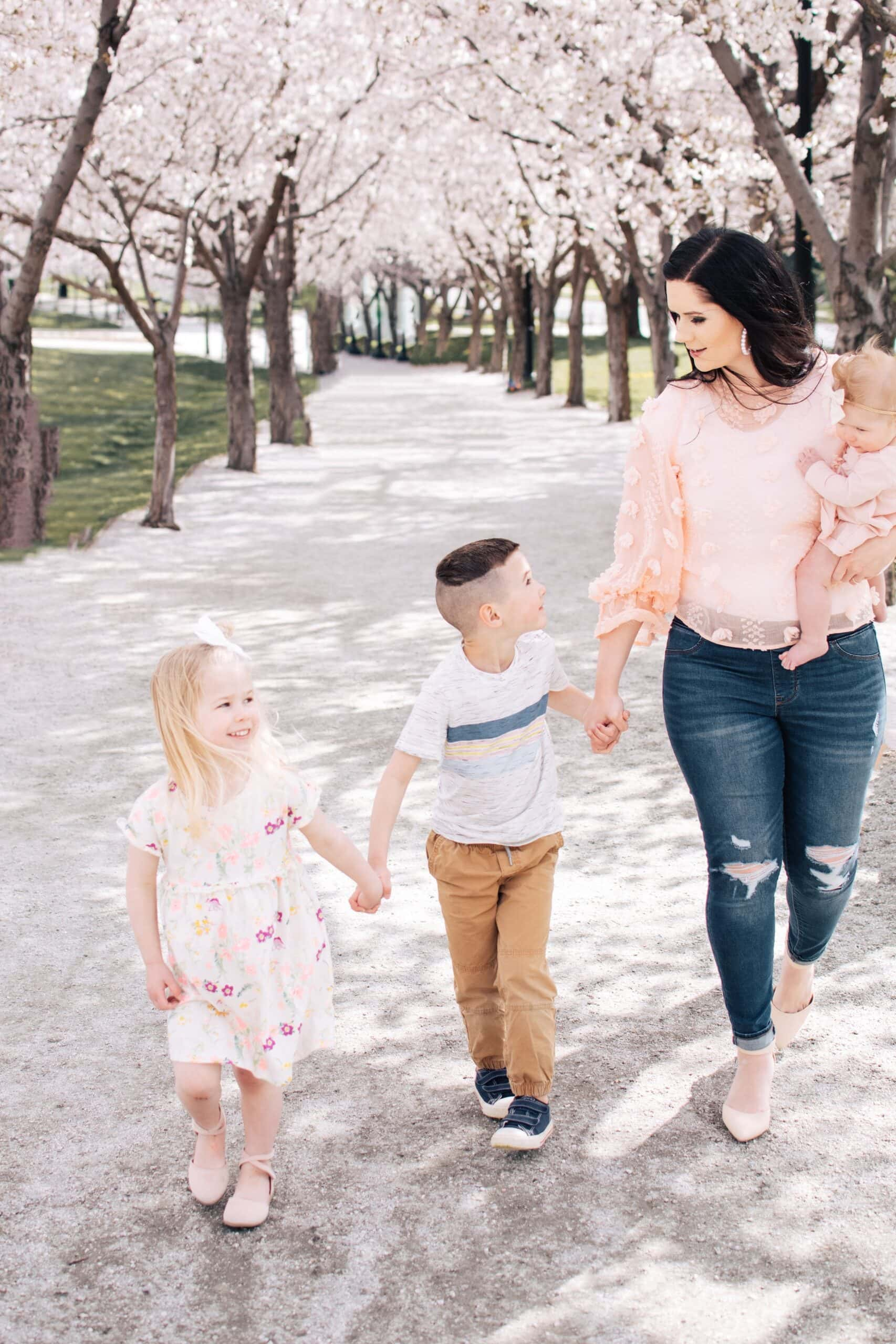 Mom and kids wear spring colors for family photos.