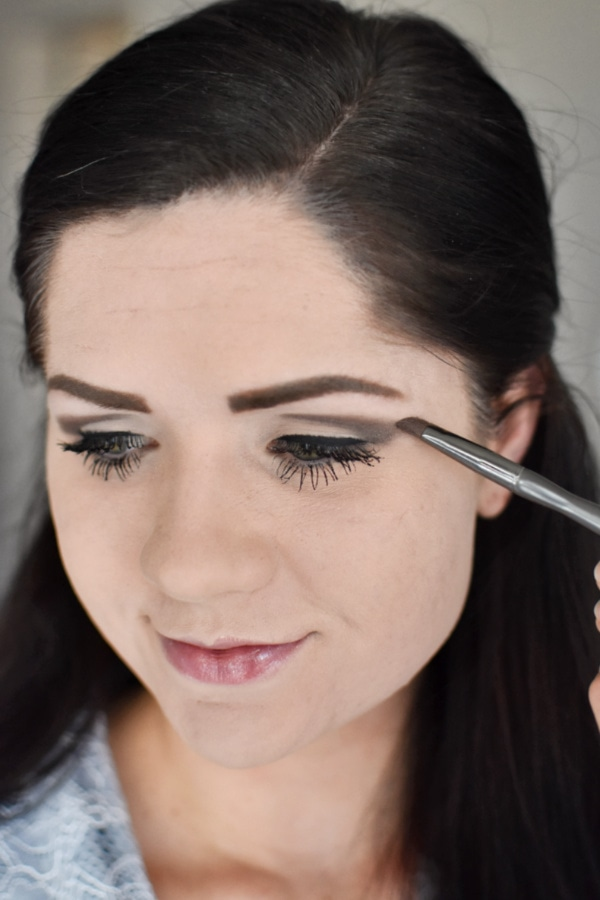 Woman shows an easy smokey eye tutorial using only drugstore makeup! I
