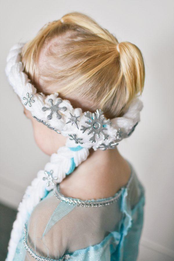 Toddler girl wears an Elsa braid.