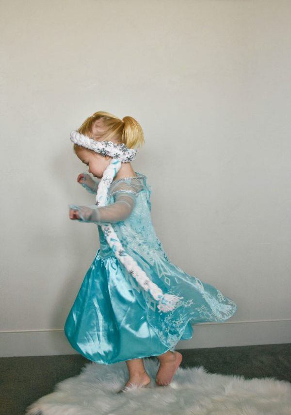 Little girl spins with Elsa hair on