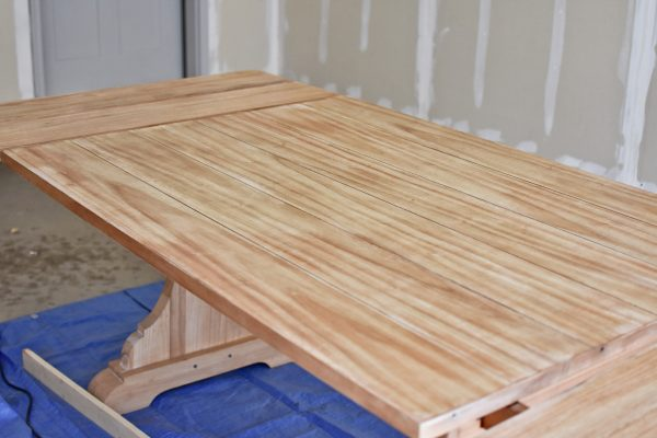 Staining a kitchen table for refinishing.