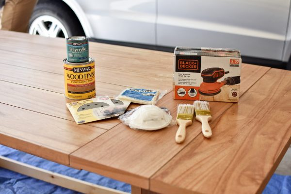All of the supplies you need to refinish a table.