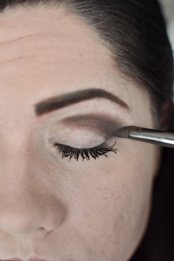 Woman blending eye shadow during an easy smokey eye tutorial
