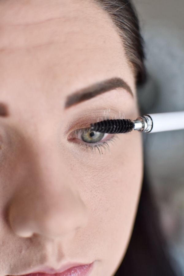 Woman brushing eyelashes for an easy smokey eye tutorial