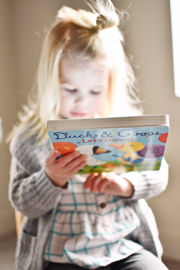 Little girl shows the best gifts for bookworms