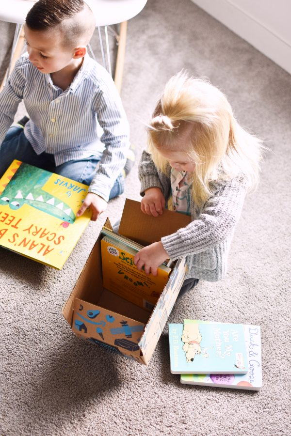 Two kids are excited because books are fun gifts