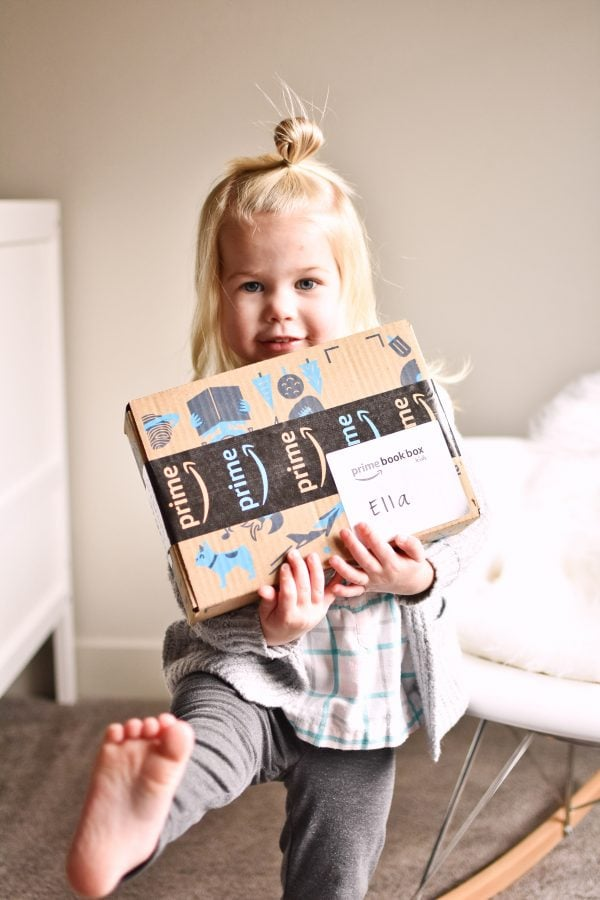 Little girl is excited about her Prime Book Box