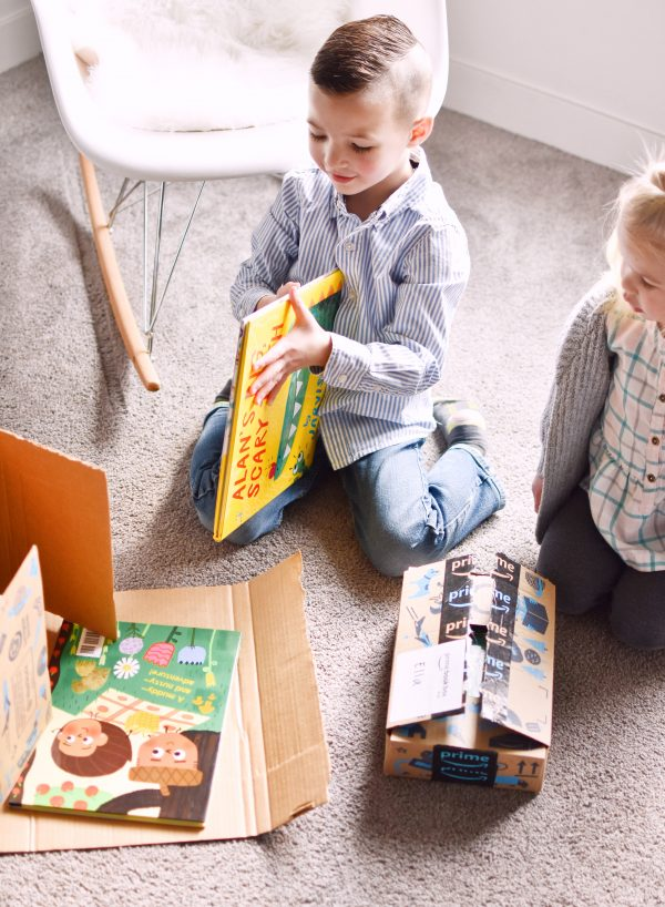 Little boy is excited about his gift for book lovers