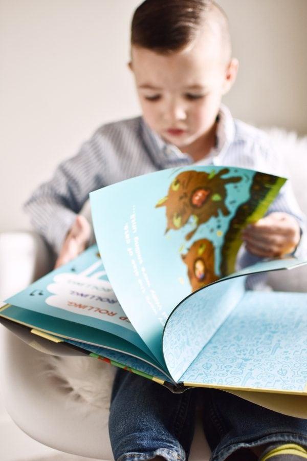Little boy looks at a book