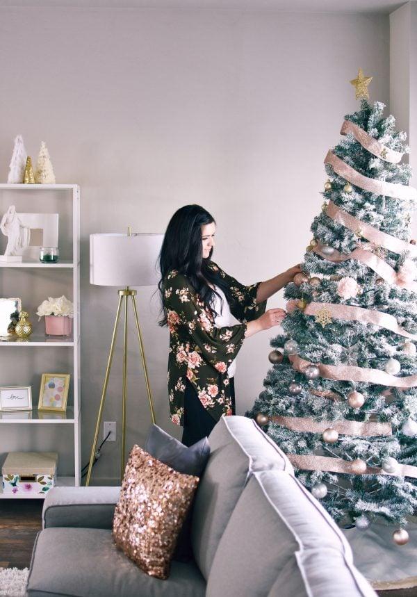 Woman decorating an elegant Christmas tree