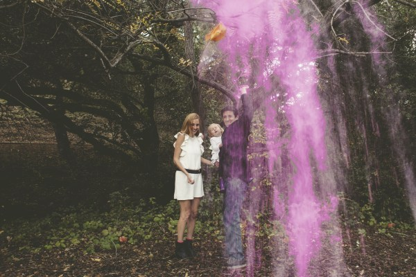 Family celebrates their baby girl with a colored powder gender reveal