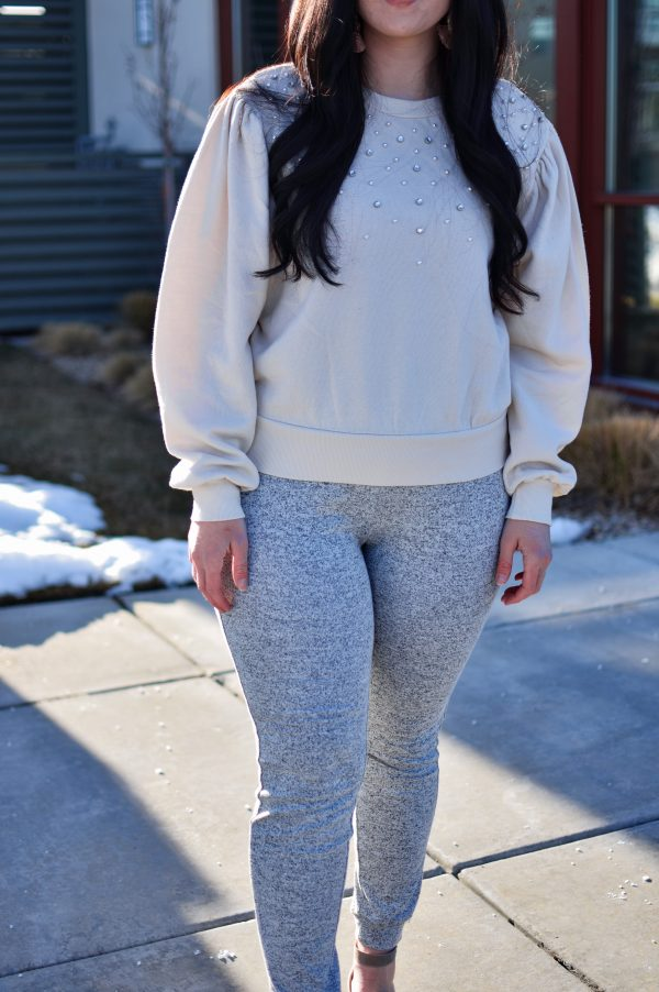 Woman wears date night athleisure outfit
