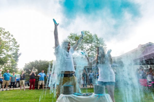 Couple celebrates their baby boy with a holi powder gender reveal