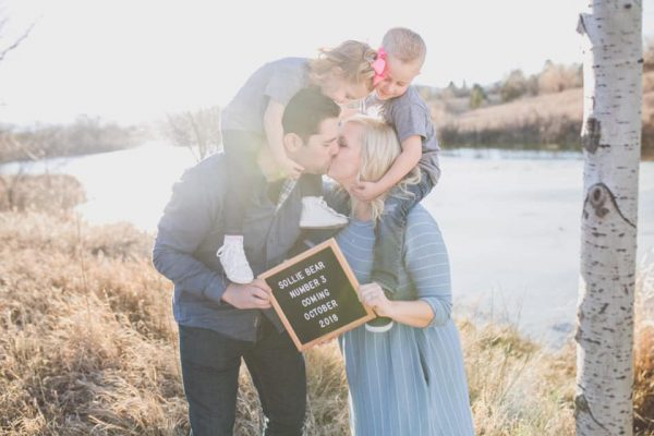 Family uses letterboard to announce another baby