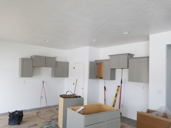 Cabinets being installed in a new house