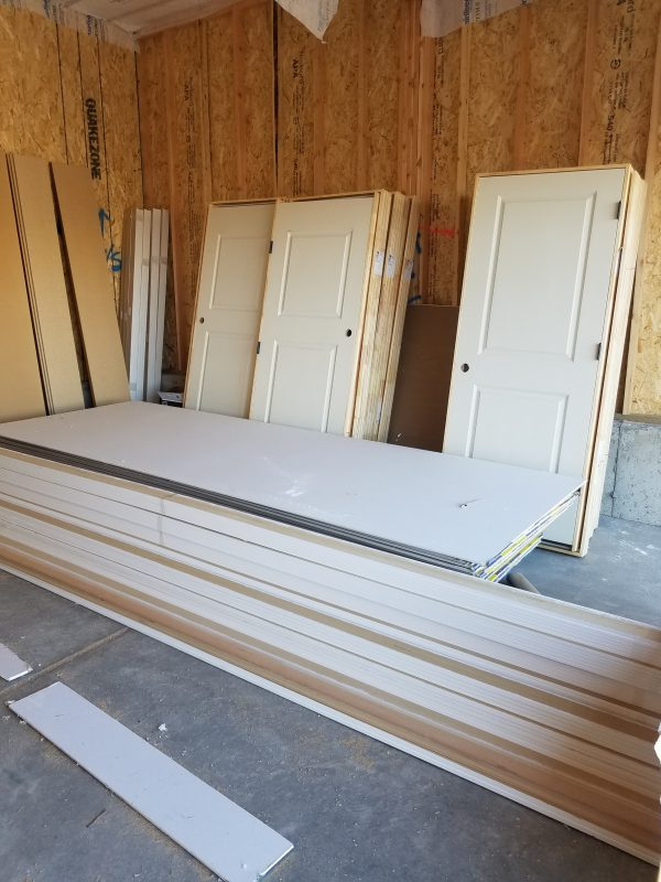 Doors and drywall supplies in an unfinished house