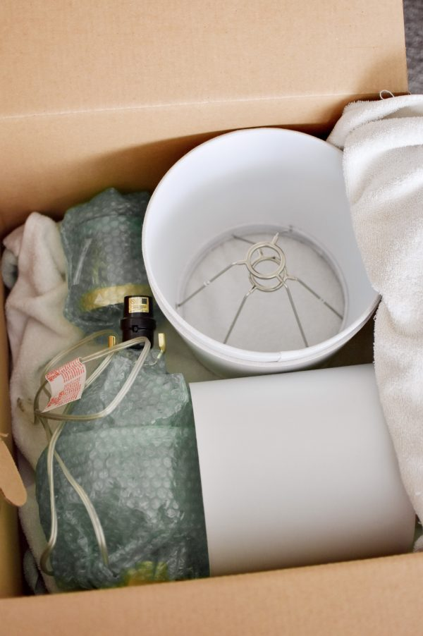One of the best DIY moving tips is to use a towel to protect fragile items.