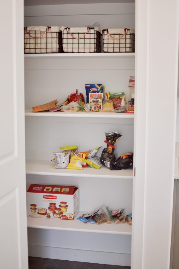 I show you how to organize a kitchen pantry like the cluttered example.