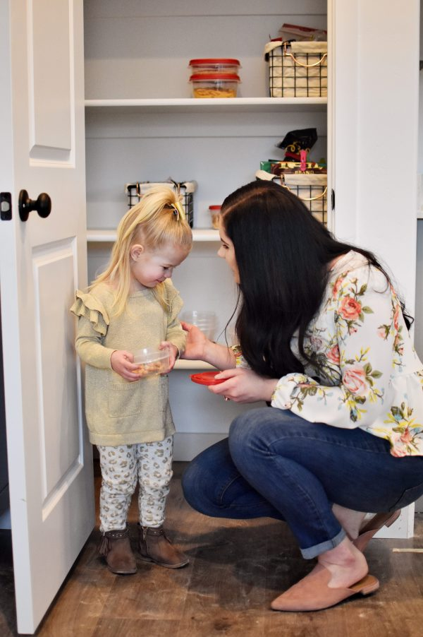 Mom teaches daugther some pantry life hacks.