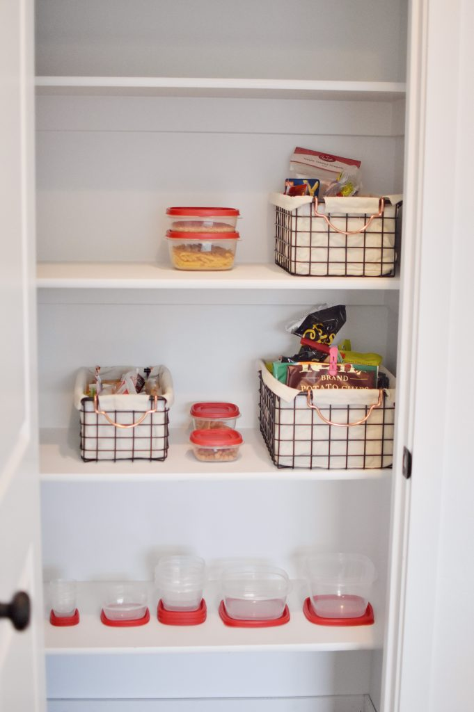 An organized pantry featuring storage ideas with Rubbermaid containers.