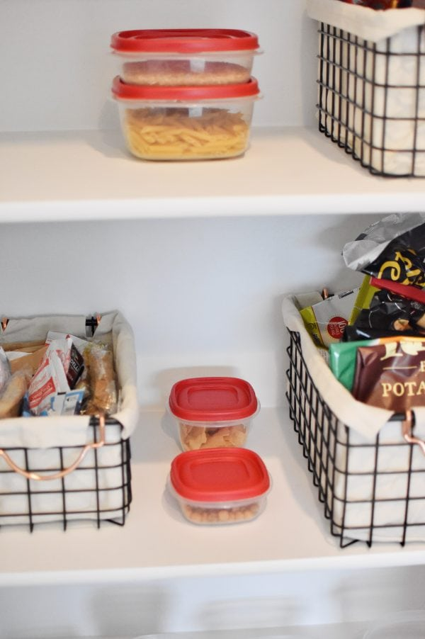 Items organized nicely is a small pantry storage solution.
