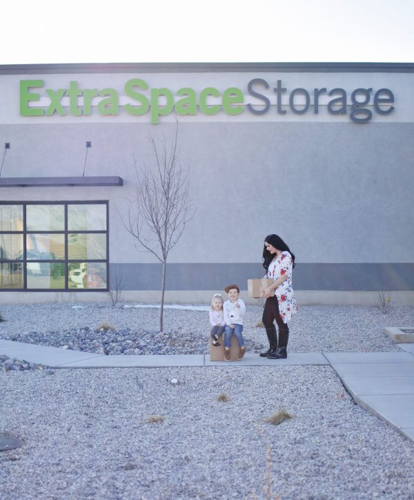 Mom and kids in front of extra space storage think of the best moving tips