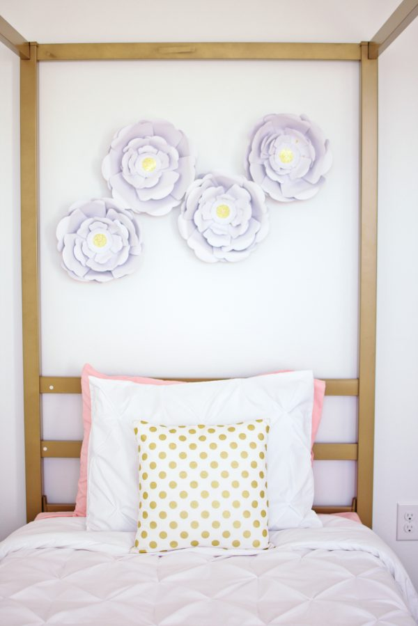 White flowers on the wall is an idea for a girls bedroom.