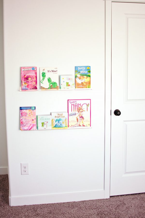 Acrylic book shelves are great kids playroom ideas.