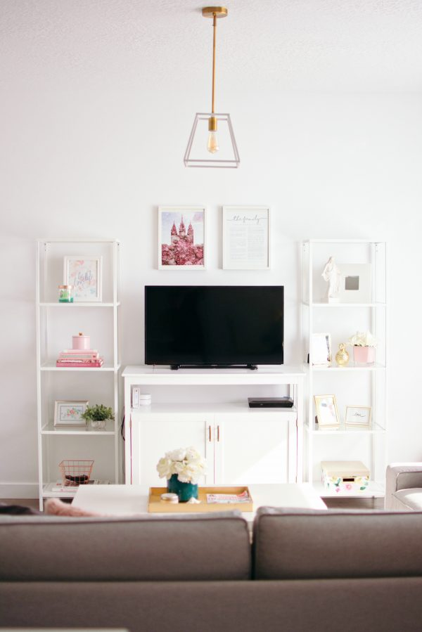 Two tall shelves by the TV stand is a great living room decor layout.