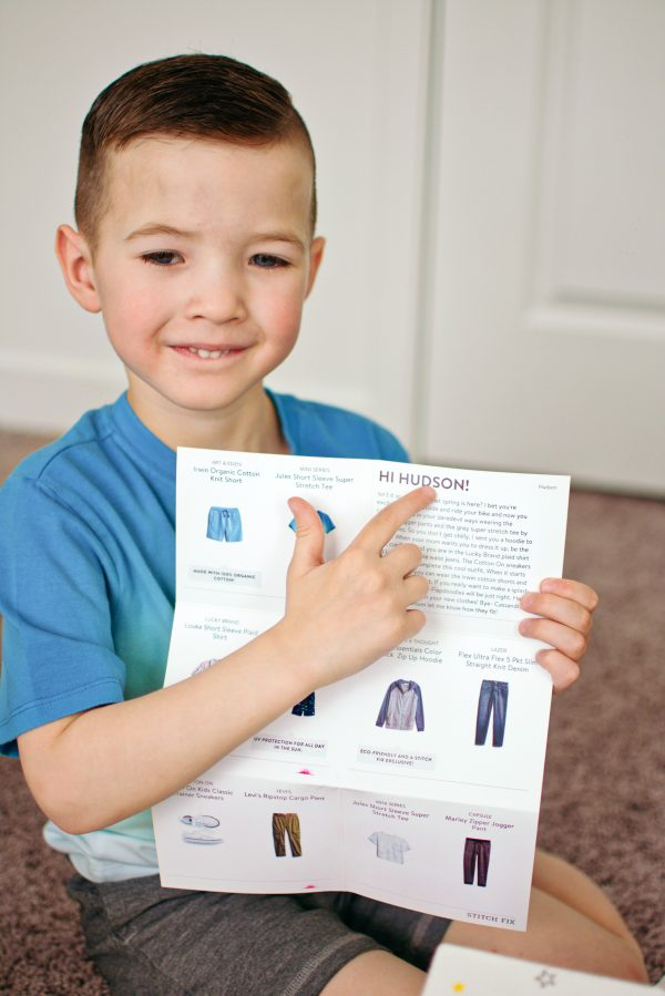 Little boy points to his personalized Stitch Fix note.