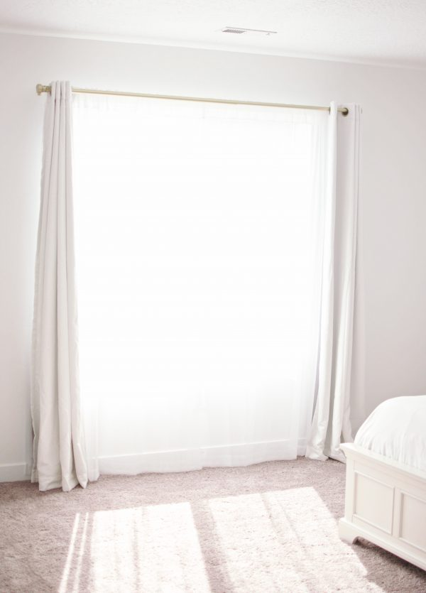 Curtains make for a romantic master bedroom.