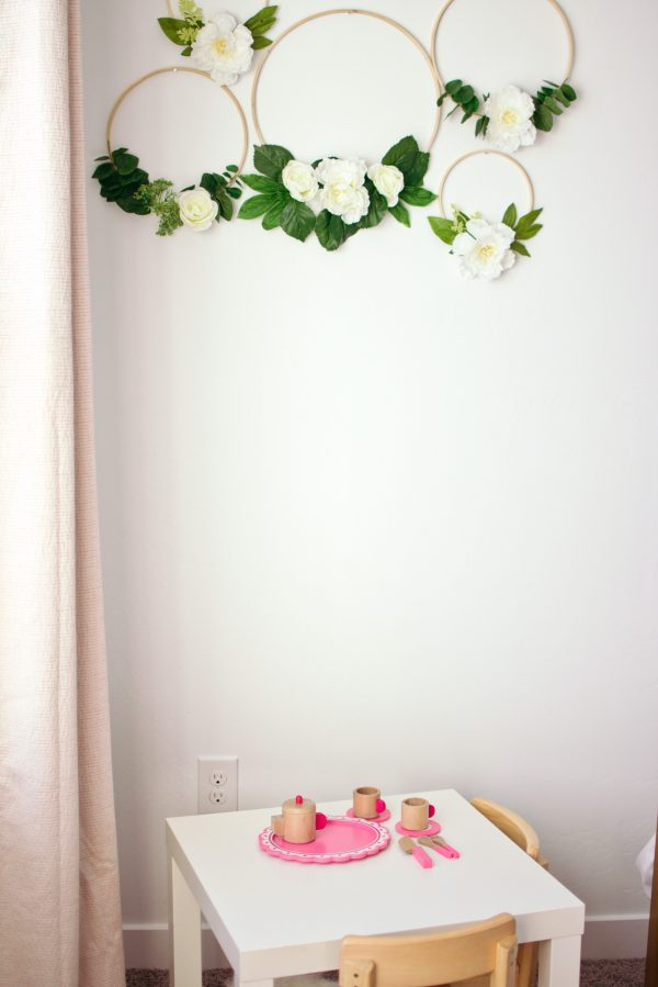 Floral hoop wreaths are an idea for a toddler girls bedroom.