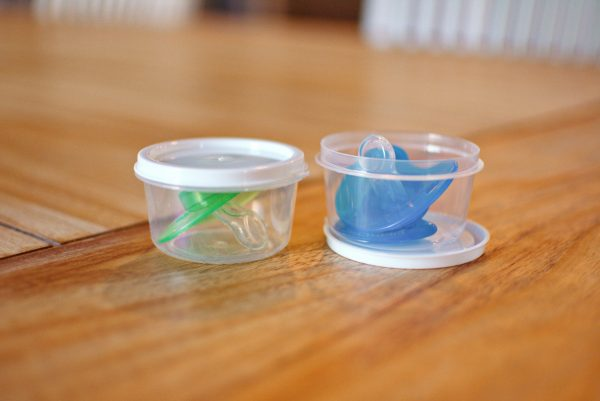 Using portion cups for binkies is a great mom hack for baby.
