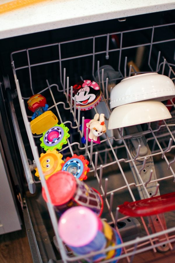 Toys sit in a dishwasher.