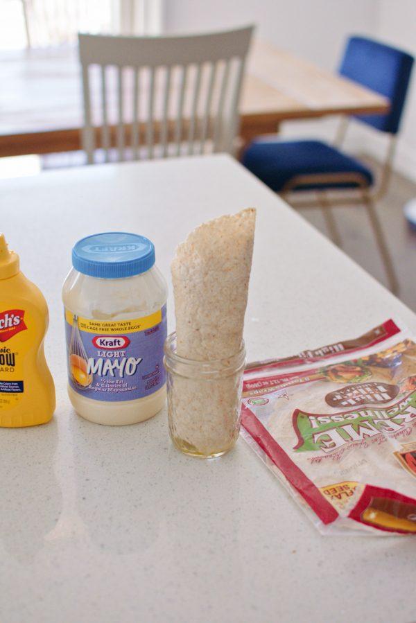 Burrito stands in a mason jar.