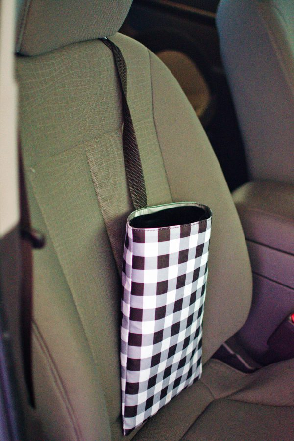 Keeping a trash bag is a great mom hack for the car.